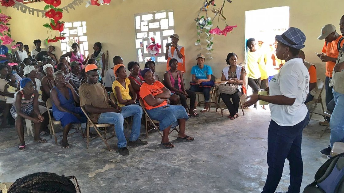 Beneficiaries meet with Concern staff prior to the distribution of NFI's in Grand Vide, a community on the island of La Gonave. Photo: Peter Doyle/Concern Worldwide.