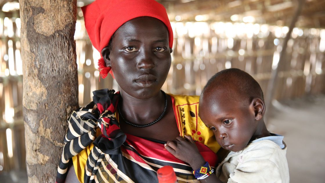 Khadra* and her two year old daughter, Jamilah*, being screened by staff of Nile Hope, a South Sudanese NGO being supported by Concern Worldwide. Photo: Kieran McConville/Concern Worldwide. *name changed for security reasons.