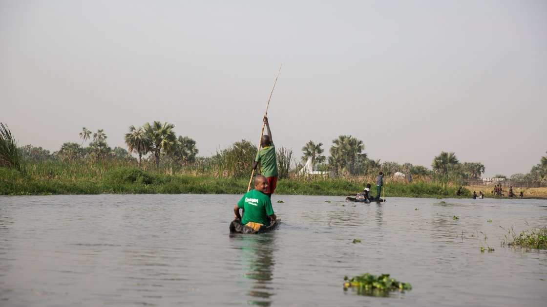 Concern South Sudan emergency nutritionist, *Abhsir travels through the swamps of Unity State by dugout canoe.March 2017. Photo by Kieran McConville, Concern Worldwide.