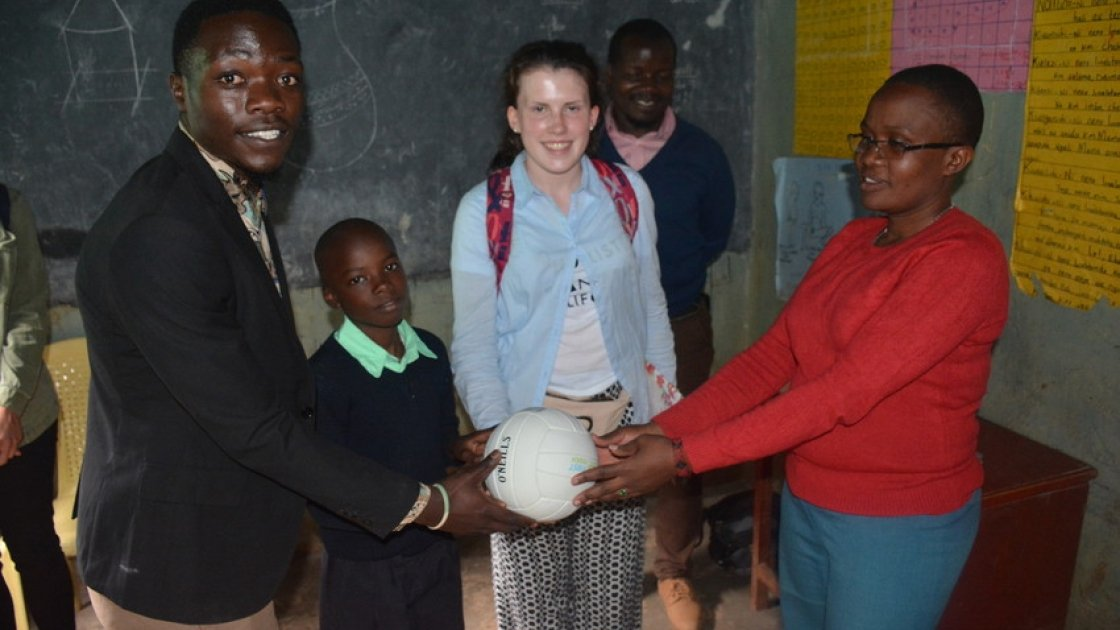 A ball from Michael Darragh McAuley is presented to head teacher Mrs Mary Nabowa and class teacher of class five in Dandora IV prep school. Photo: Francis Mwangi/Concern Worldwide