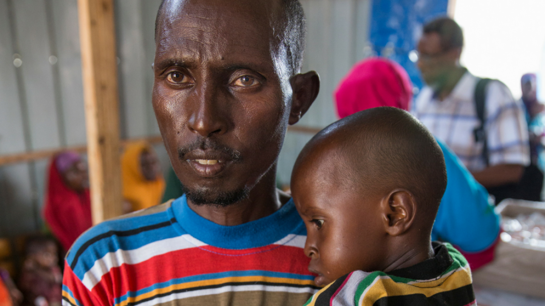 Abdullahi* with his son, Abhsir* (4), at a nutrition centre run by Concern Worldwide in Mogadishu in Somalia. Photo: Kieran McConville, March 2017.