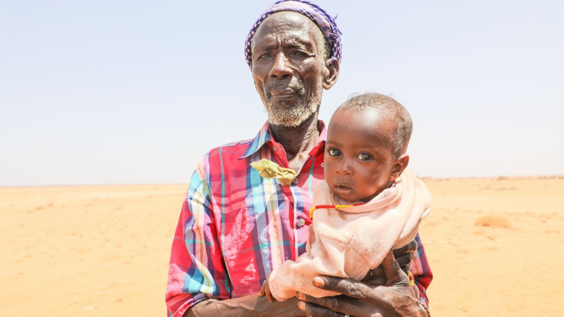 Atho Shama (78) with his five month old son Adano. His wife Iyesa is severely malnourished, weighing only 32kgs and complaining of headaches and fever. Photo: Jennifer K Nolan / Concern Worldwide, Feb 2017.