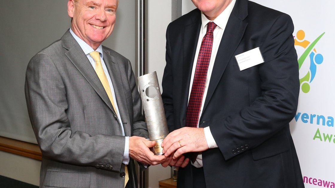 Concern's chairperson Tom Shipsey accepts a Special Recognition award from Diarmaid O'Corrbui, CEO of the Carmichael Centre at the Good Governance Awards. Photo: Marc O'Sullican/Concern Worldwide.