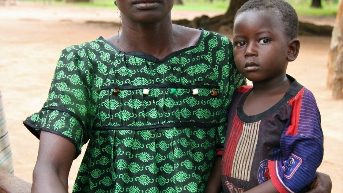 Beatrice* with her son, Robert*. Like thousands of others, Beatrice fled with her family to DRC when rebels attacked her village. Photo: Caitriona Dowd/Concern Worldwide.