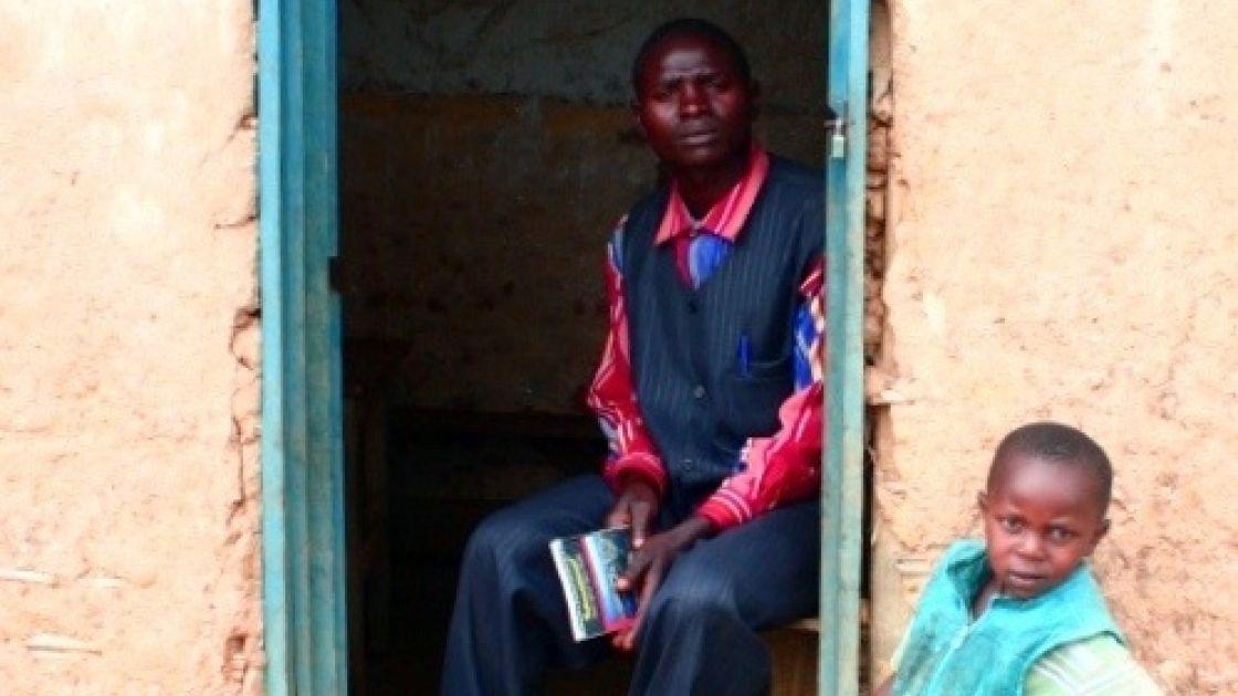 Teacher Bitwaki Ntezi sits inside his home in Kazinga Village, Democratic Republic of Congo Photo taken by Concern Worldwide.