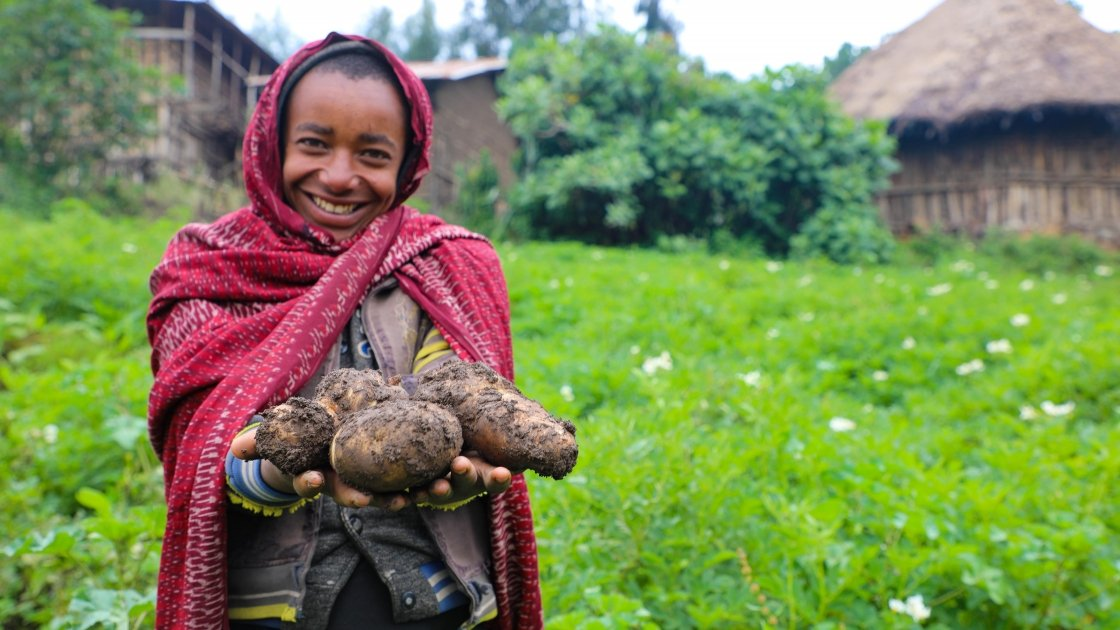 Mehamed Ahimed Ali (15) shows some of the potatoes from his family's successful harvest thanks to Concern. Photo: Jennifer Nolan, Ethiopia, 2017.