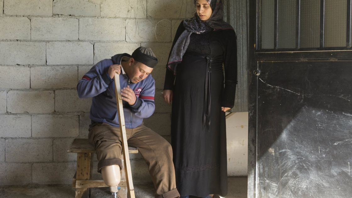 Omar* was a farmer in Syria before he lost his leg to a mine on his land. He now lives in a shelter with his wife Fatimah who is pregnant and their children. The shelter has been rehabilitated by the Concern team in northern Lebanon. Photo: Chantale Fahmi/Concern Worldwide 2017