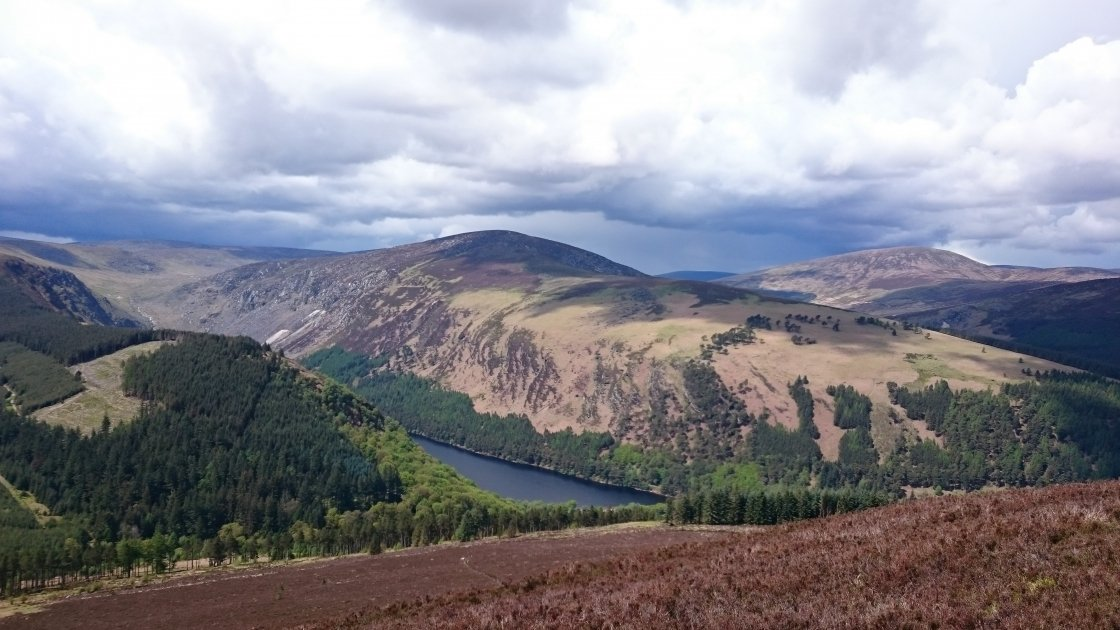 Overlooking Glendalough with Climb4Concern Three Glens Challenge. Photo by: Barry Murphy.