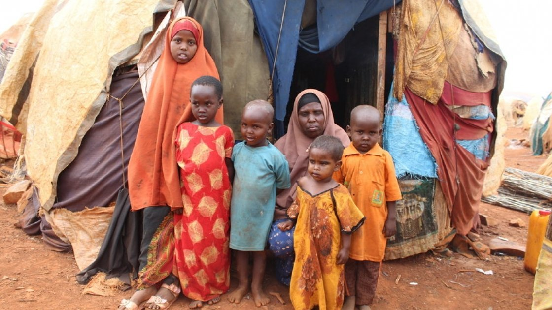 Khadra* with five of her seven children outside their makeshift house in an IDP camp in Somalia. Photo: Alinur Ali Mohamed/ Concern Worldwide