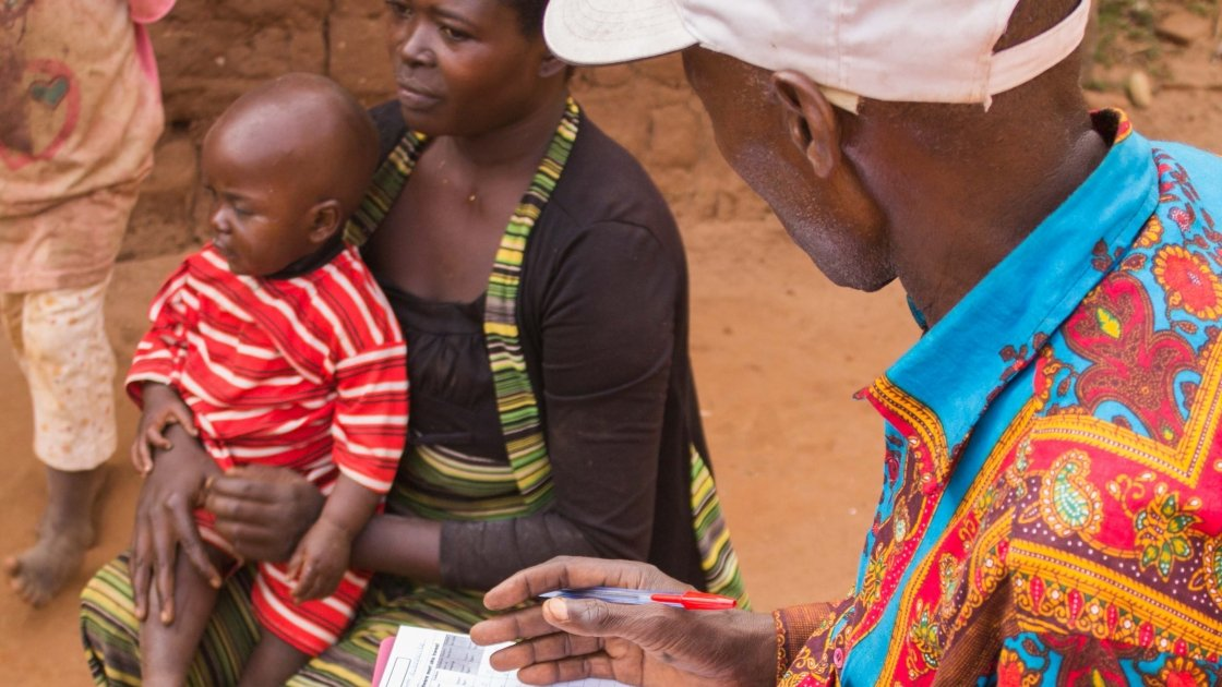 Elisa and her daughter Josephine being screened by a community health worker in Cibitoke. Photo: Irenee Nduwayezu/Concern Worldwide.