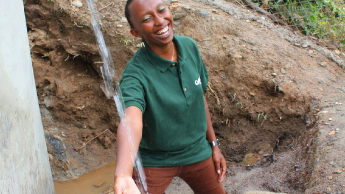 Gloria Kafuria, Concern Worldwide water and sanitation engineer, at a solar water system that she designed in Tanzania. Photo taken by Crystal Wells/Concern Worldwide.