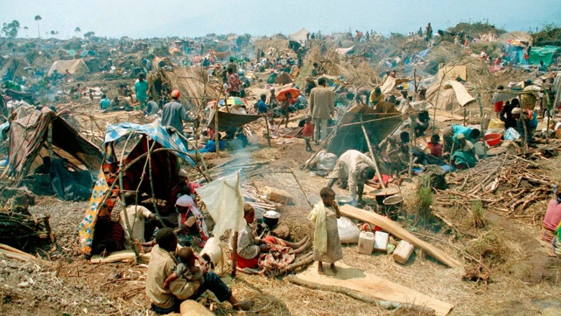 Rwandan refugees gather on the roadside near Goma, having just crossed the border into Zaire in 1994. Photo: Concern Worldwide.
