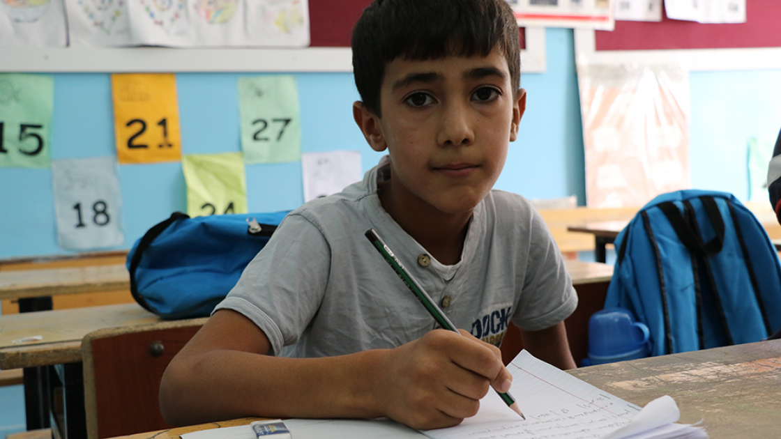 A young boy pictured at school.