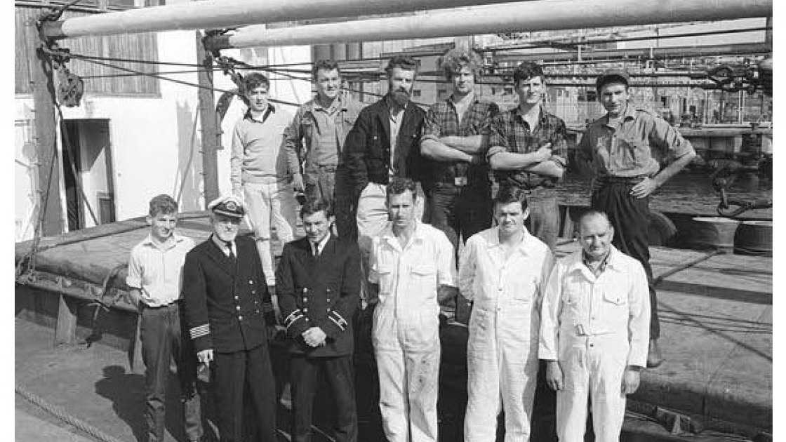 The Crew of the Columcille Top L-R Kevin Edwards (Cook), Nickey Beggs (Bosun), Ollie Harwick (2nd Mate), John McGrath (AB), Brian Byrne (AB), Tony O'Moore (AB) Bottom L-R Karl Vekins ( Catering Boy), Padraig O'Shea (Captain), Niall Foley (1st Mate), Fr. Joe Fitzgibbons (3rd engineer), Peter Shortall (2nd engineer), Kevin O'Reilly (Chief engineer). Photo: Concern Worldwide