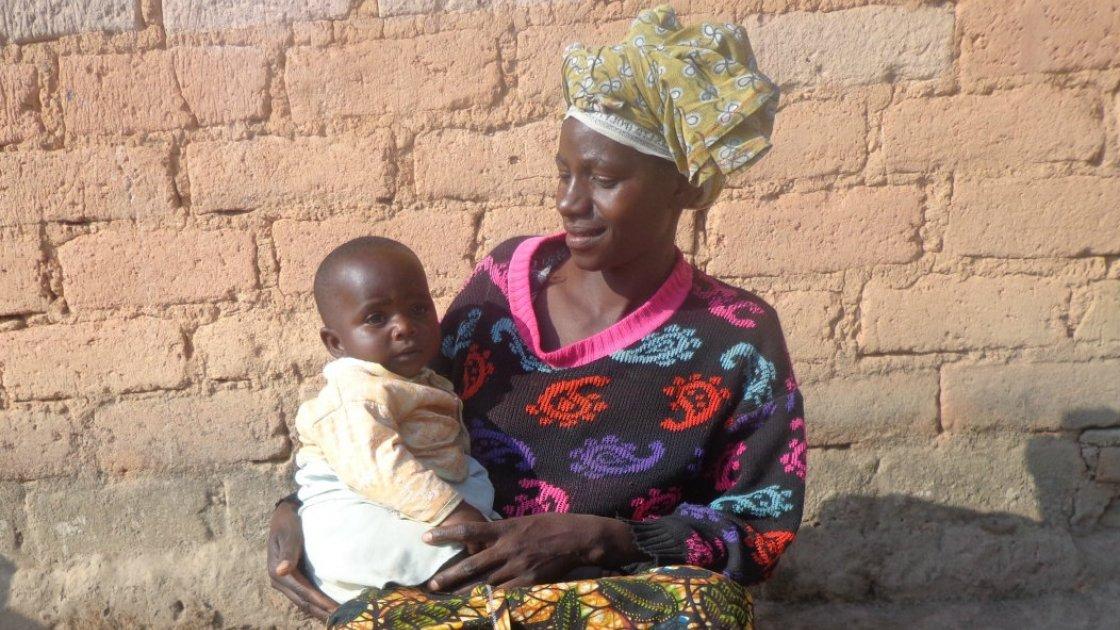 Thecla Abdul Lugenge with her youngest child Asha in Mfriga village, Mfriga ward, Njombe district, Irigna region. Photograph taken by: Lydia Mushengezi/Concern Worldwide.