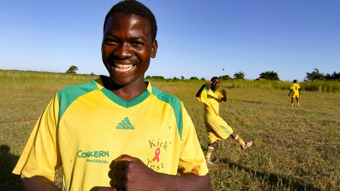 Mwale Chibiliro (18) from Nkhotakota, Malawi received a sports kit and football boots from Concern Worldwide. He is part of the Blue Eagle Football Club that was formed by Concern. Photo: Jennifer Nolan/Concern Worldwide.