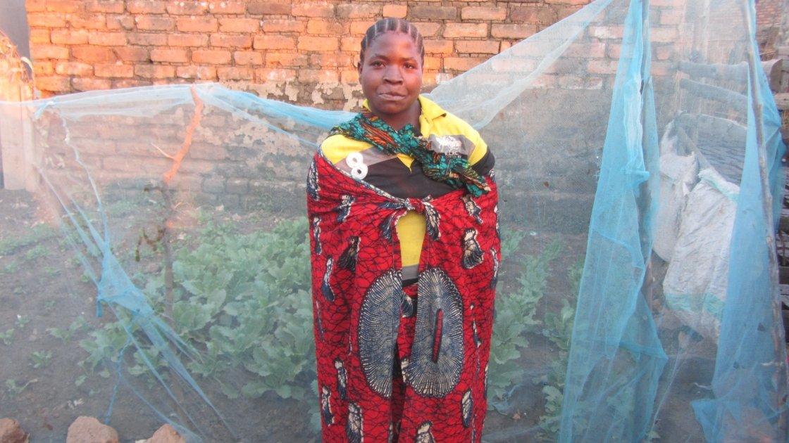 Sada Madawa from Idimi Village, Ihango Ward, Mbeya in her kitchen garden. Concern worked with communities to create kitchen gardens like this through the SUN programme. Photograph taken by Caroline Baker/Concern Worldwide.