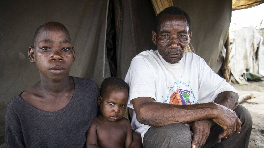 Saide in Namacurra with his children after the flood in his district of Zambezia, Mozambique. Photo taken by Crystal Wells/Concern Worldwide