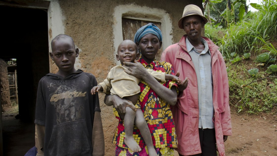 Mukankaka Seraphine and Ruilanga Vianey with two of their five children in front of their home in southern Rwanda. Credit: Crystal Wells Concern Worldwide