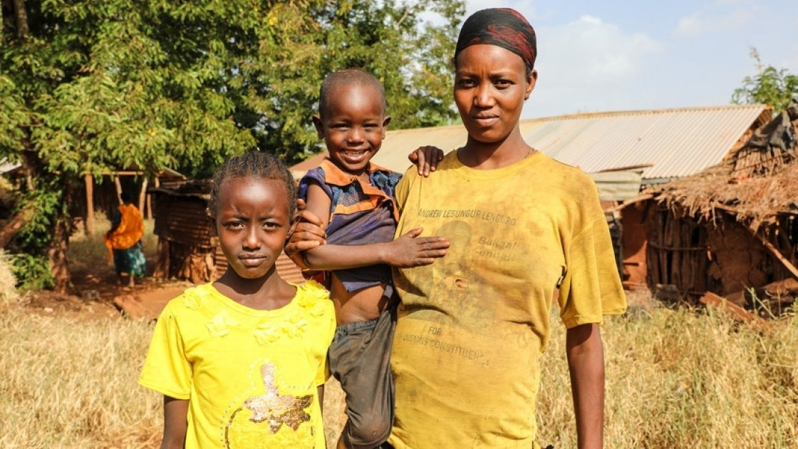 Nasino Asuran (20) is six months pregnant with her third child. Pictured here with her daughter Nangiro and son Sampson, the family are malnourished and have not eaten all day. They normally eat boiled maize once a day. Leyai Village, Marsabit, Kenya. Photo: Jennifer Nolan / Concern Worldwide, Feb 2017.