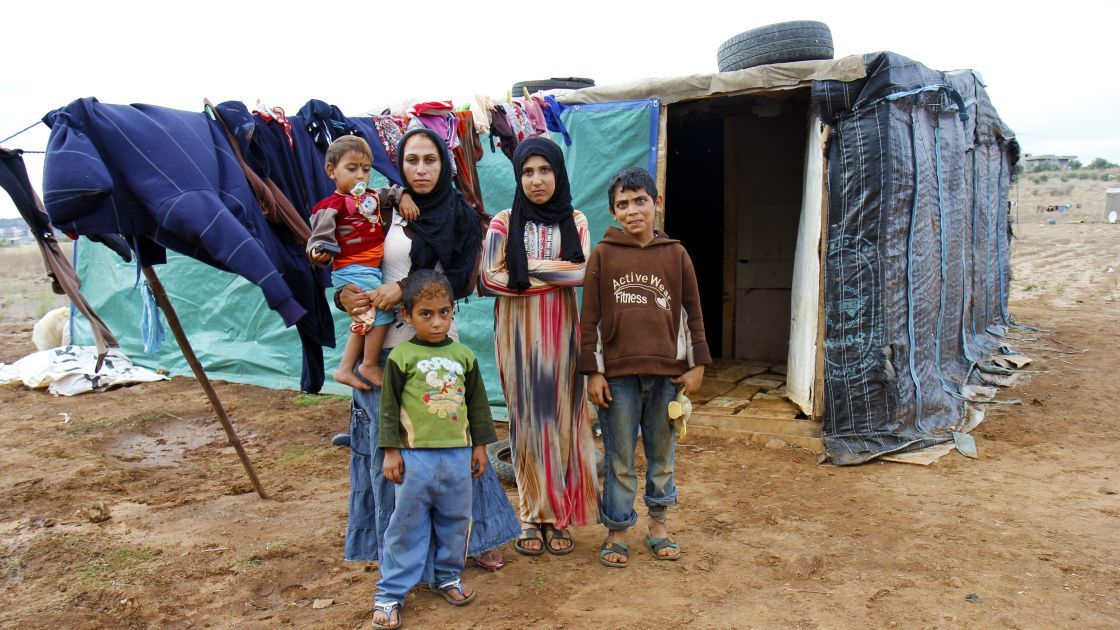 Our charity work in Syria and Lebanon includes providing shelter. Samar with her four children outside their makeshift shelter. For security reasons, we cannot state where this image was taken. Real names have also been changed.