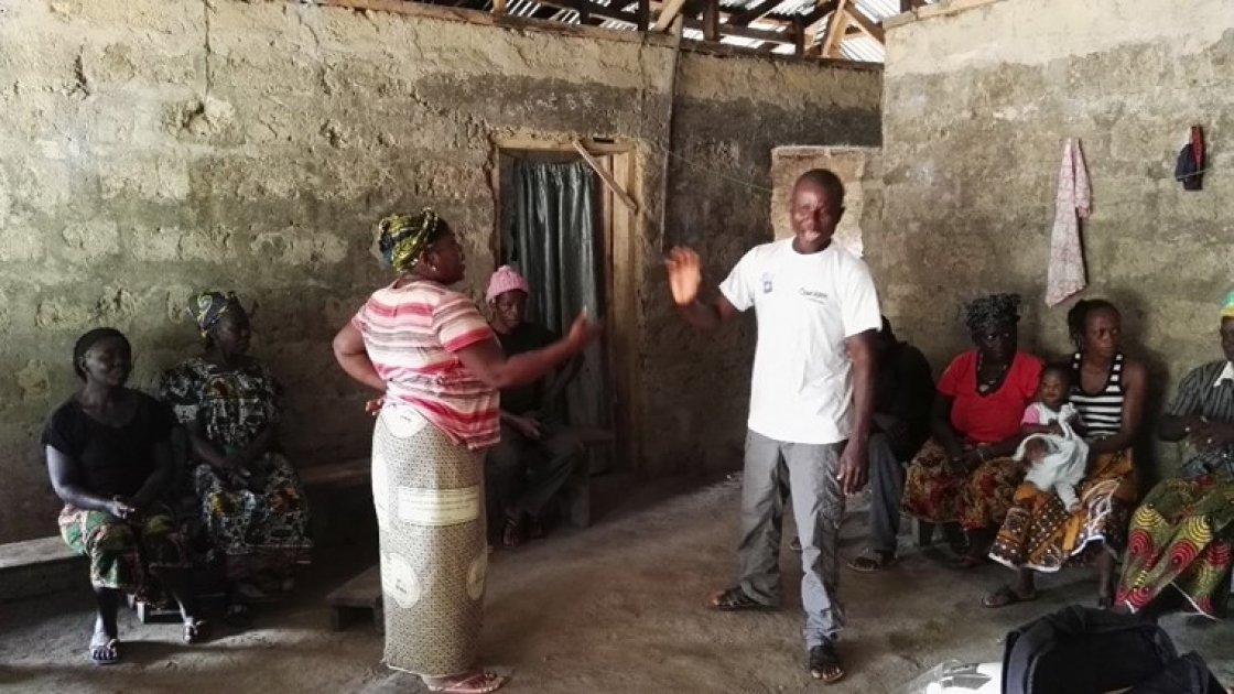 A couple acting out a role play as part of a gender transformational session with couples in Sierra Leone. Photo by Adèle Fox, December 2017