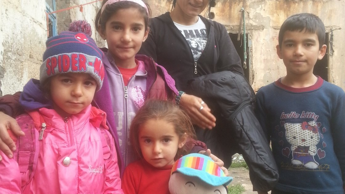 Souad and her four children outside their rented accommodation. Souad's three school-aged children missed three years of schooling in Turkey, before accessing a Concern-supported government school. Photo: Concern Worldwide.