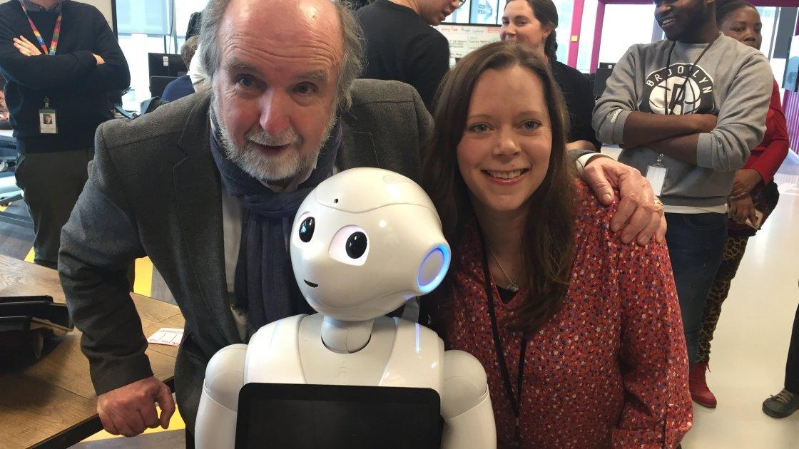 Michael Doorly and Ellen Ward of Concern meeting Pepper the Robot in Accenture's Dock building in Dublin. Photo: Concern Worldwide