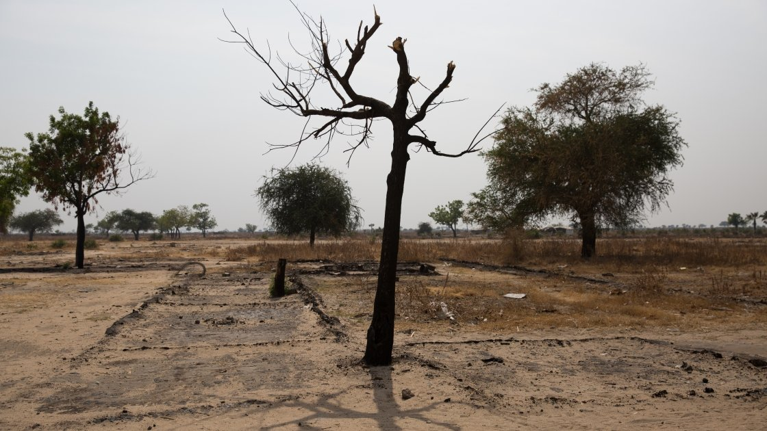 All that remains of Nile Hope's compound that was burnt to the ground during a raid by soldiers in a Leer County village last year. South Sudan, March 2017. Photo: Kieran McConville, Concern Worldwide
