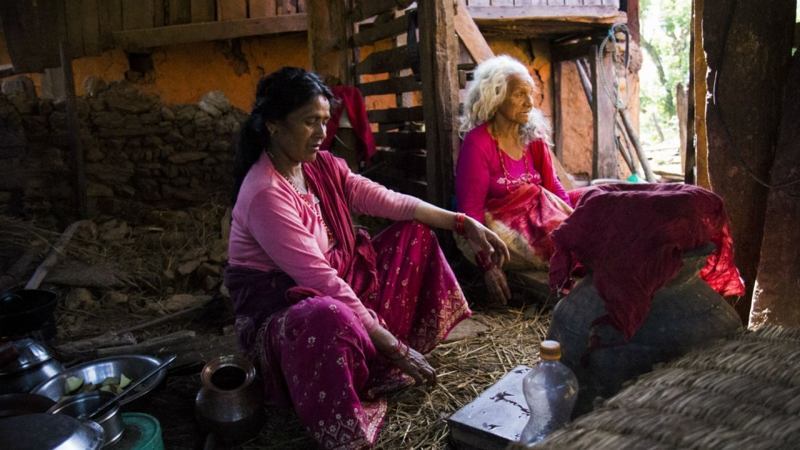 Two women cook in a house left standing after the Nepal earthquake. Photo taken by Crystal Wells/Concern Worldwide