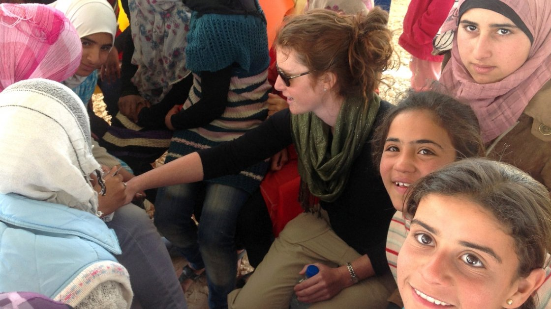 Abby Bruell, Concern's Humanitarian Program & Policy Officer, gets her hands decorated with henna at a youth centre. Photo: Concern Worldwide.