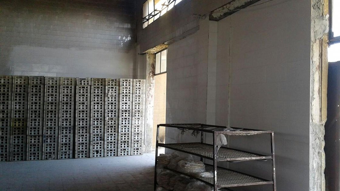One of the bakeries Concern is restoring within Syria. In the foreground you can see bags of bread the bakery has already begun to produce. Photo: Concern Worldwide.