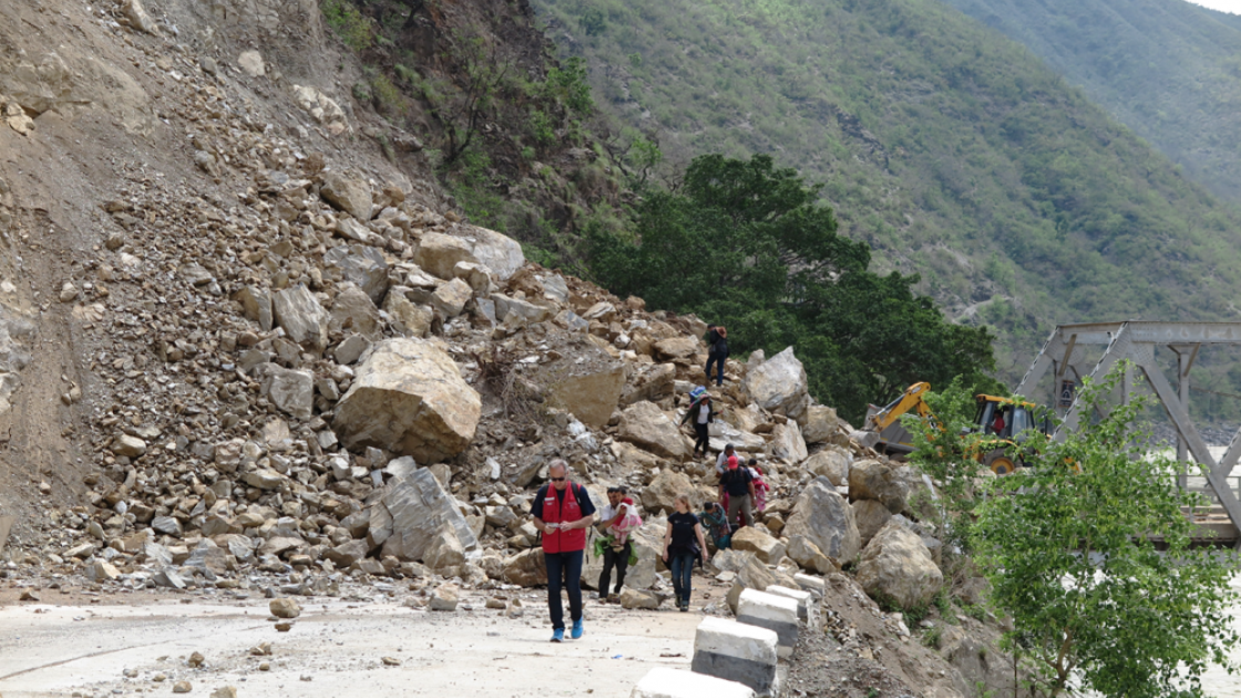 Bulldozers work to re-open a bridge at Khurkot, Ramechhap. Photo taken by Helvetas.