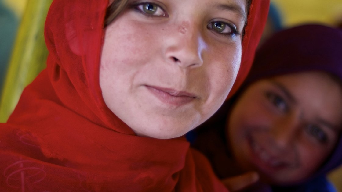 Sediqa holds a book at the Khashai Dun School in Takhar Province, north-eastern Afghanistan. Photo taken by Kieran McConville / Concern Worldwide 2013.