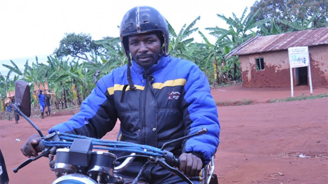 Bernard Kamuhanda, a volunteer in agricultural development, on his motorcycle taxi in Nterwenge, Tanzania. Photo taken by Concern Worldwide.