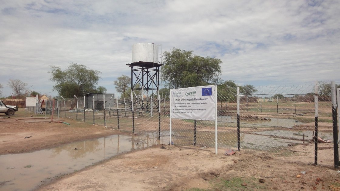 Rehabilitated water yard with storage tank and drinking taps in Meyriam locality, West Kordofan State, Republic of Sudan. Photo: Concern Worldwide.