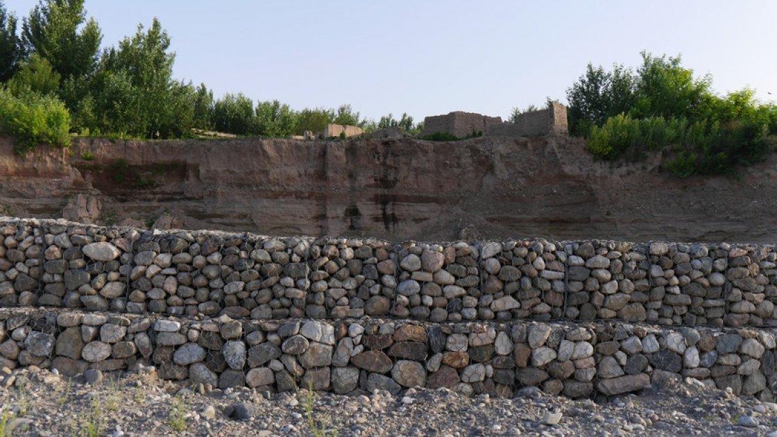 Concern-built flood defences protect villages from further destruction in Rustaq district, Takhar province Afghanistan. Photo: Kieran McConville / Concern Worldwide.