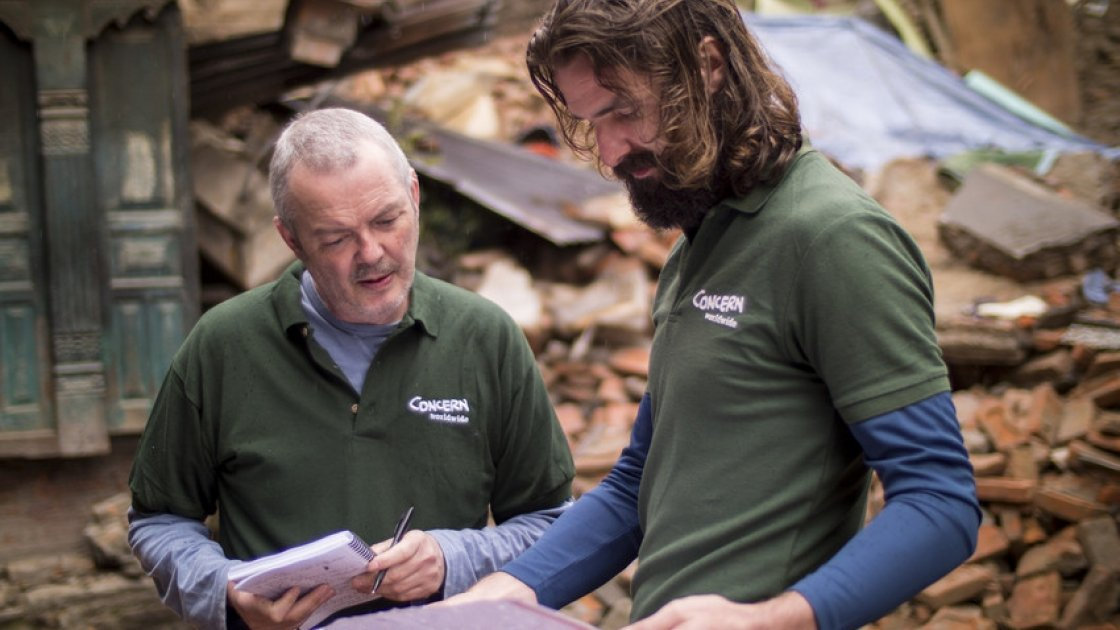 Ros O'Sullivan speaking to Graham Woodstock in Kathmandu, just after the 2015 earthquake struck. Photo: Concern Worldwide.