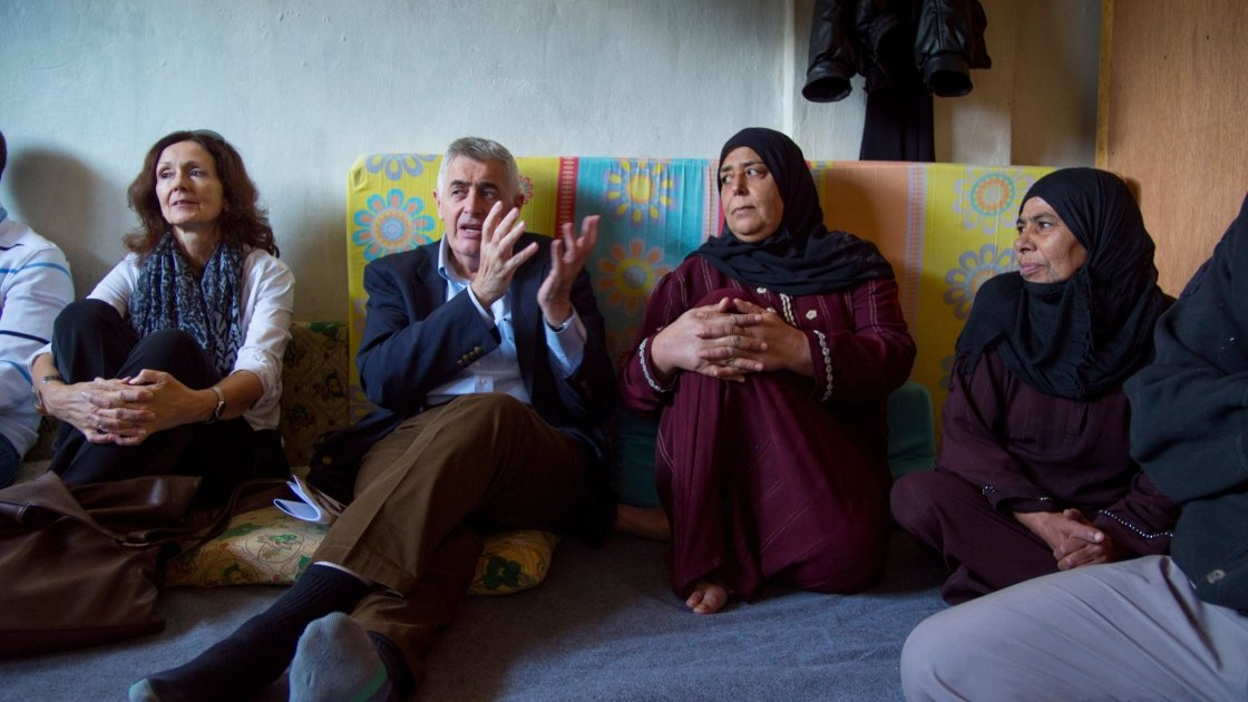 Concern Worldwide CEO Dominic MacSorley and Lebanon Country Director Elke Leidel with residents of a collective center for Syrian refugees in Northern Lebanon. Photo: Kieran McConville