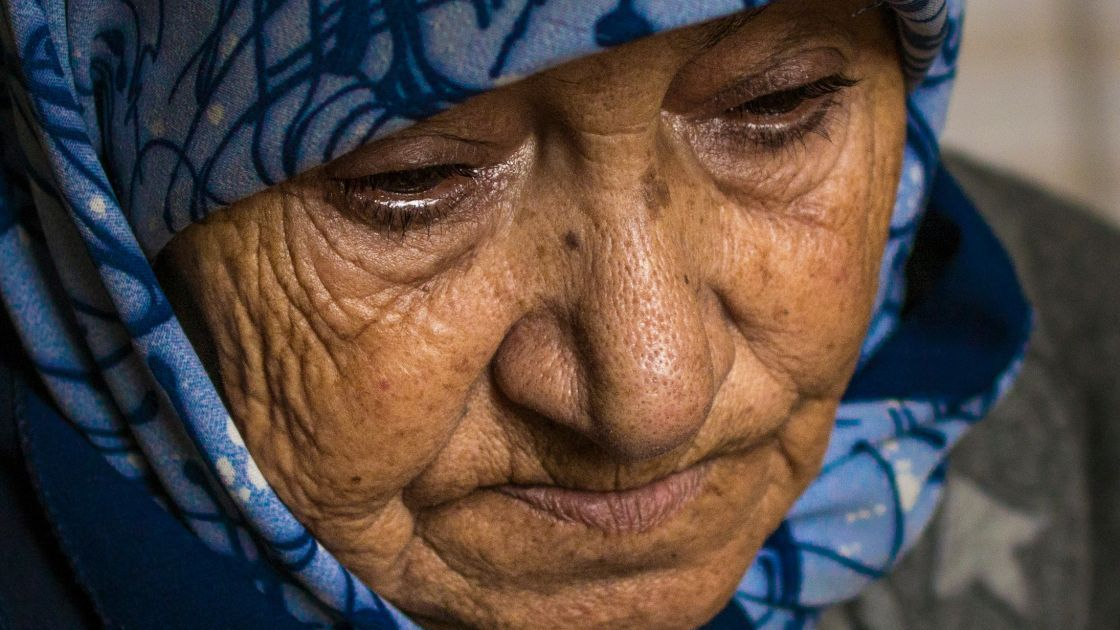 """""""Iman"""" lost 19 members of her family, including her husband, all of her children except one daughter, and all of her grandchildren except one grandson in a bombing attack on their home in Syria. Photo: Kieran McConville / Concern Worldwide."""