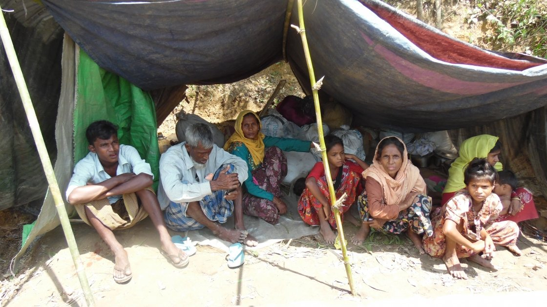 Rohingya refugees arriving to Cox's Bazar after a ten day walk from Myanmar. They are sheltering under a makeshift structure requiring food, water shelter and healthcare. Photo: Bijoy Krishna Nath/Concern Worldwide.