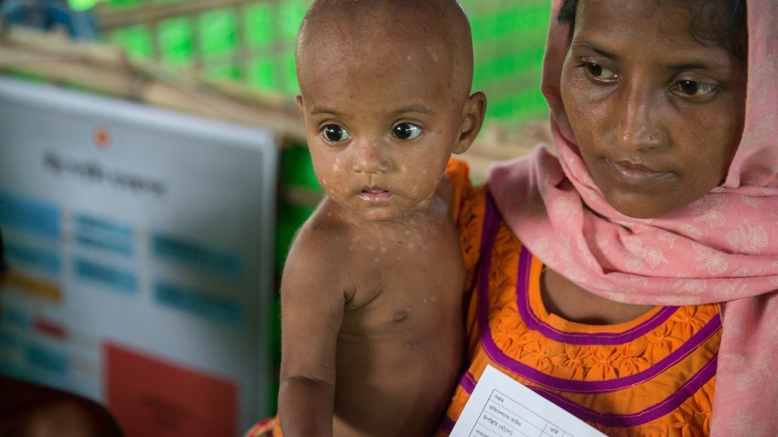 Lelia* and Tamir* at Concern Worldwide's Nutrition Support Centre at Hakim Para camp in Cox's Bazar, Bangladesh. Photo: Kieran McConville/Concern Worldwide.