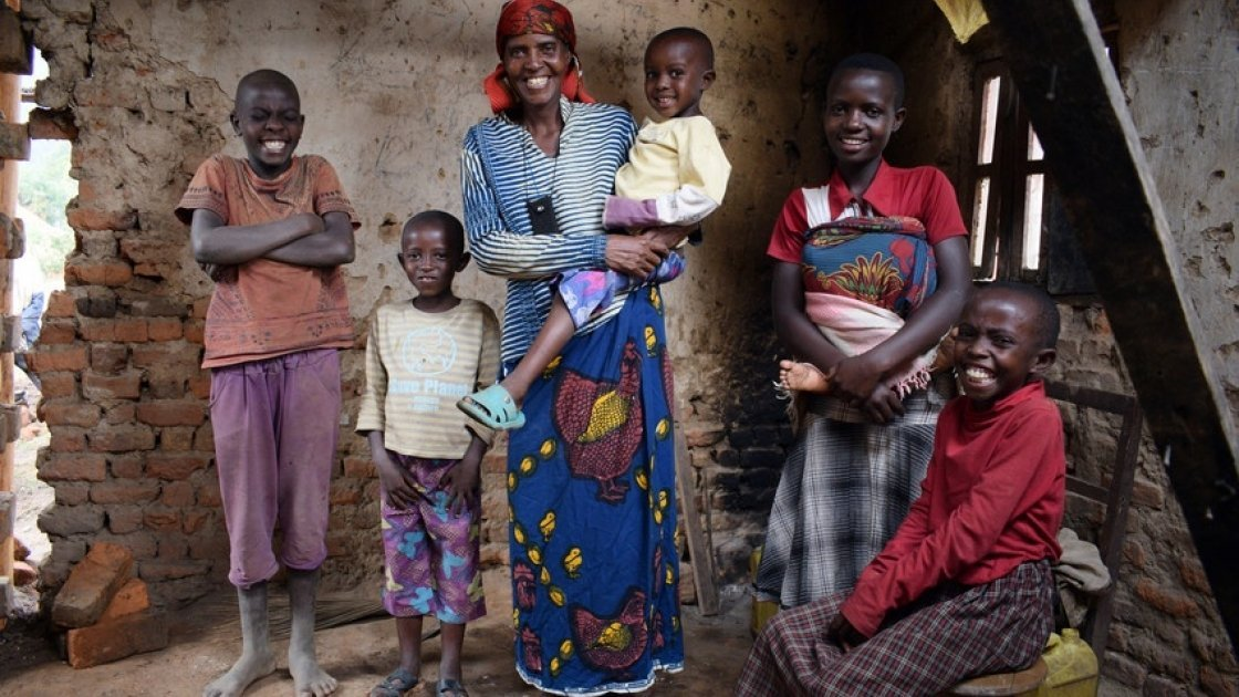Just a few months after joining Concern's Graduation programme, Violette Bukeyeneza (pictured here with her family) started a small business selling banana juice. Photo: Darren Vaughan / Concern Worldwide.