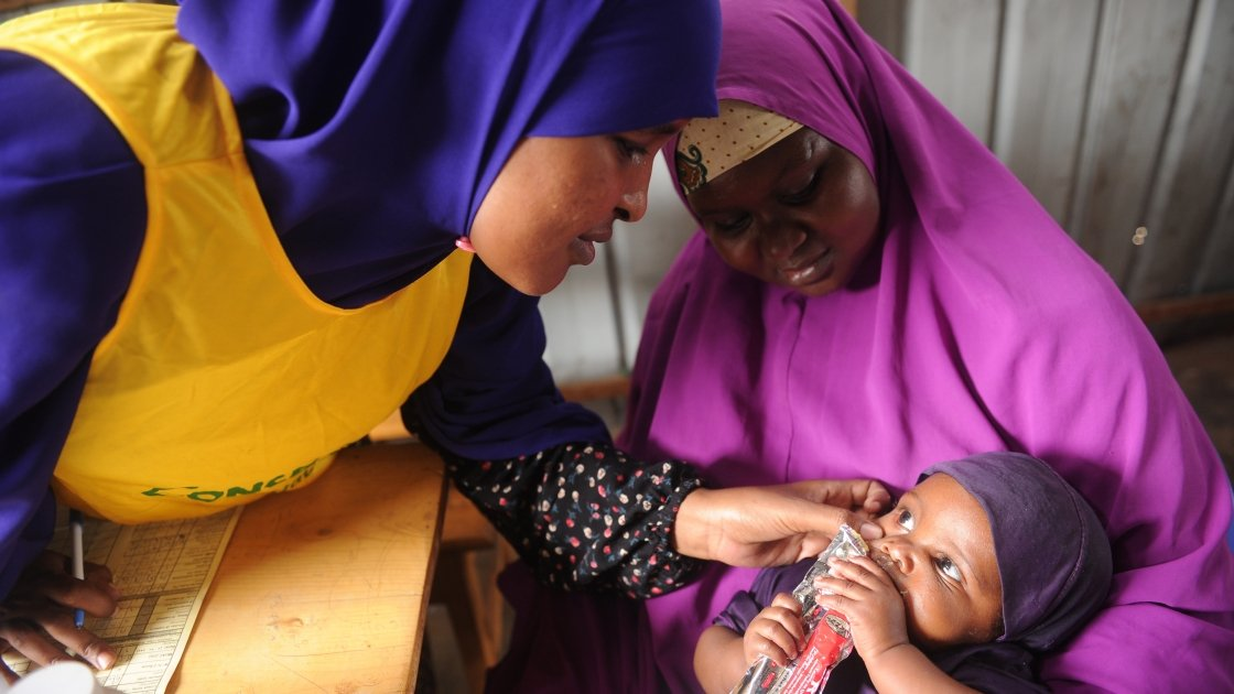 Hani, Nala and a Concern worker at a Concern support health centre in Somalia. Photo: Mohamed Abdiwahab/Concern Worldwide.