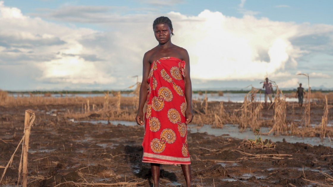 Farmer Malita (25) inspects whats left of her field after extensive flooding. The entire crop has been ruined just one month before harvest. Photo: Gavin Douglas/Concern Worldwide