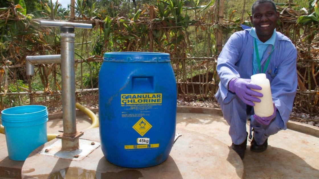 Eustachkius Sabas, a Senior Water Laboratory Technician for Concern Tanzania, disinfecting the water point with chlorine to make it safe for communities to drink. Photo: Jennifer O'Gorman / Concern Worldwide.