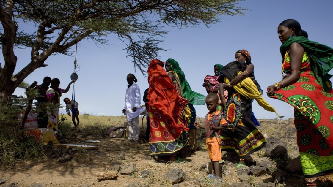 Concern's outreach nutrition programme reaches communities who would otherwise have no access to health care. Clinics are held wherever possible, here under the shade of an acacia tree in Sahgel, Chalbi District in Marsabit, Kenya. Photo: Gideon Mendel.