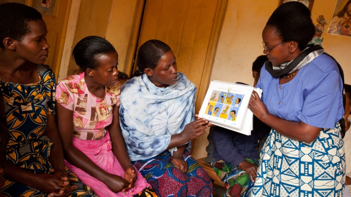 Bahomwana care group meets in Gasambu village, Rwanda. They exchange ideas and challenges to accomplish and improve their work as a Community Health Workers. Photo: Esther Havens.