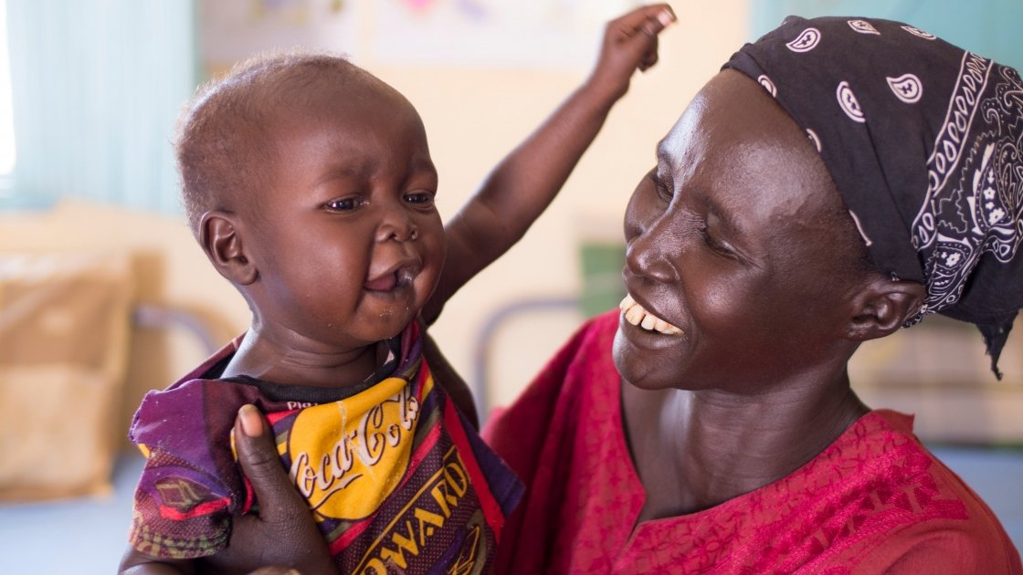 Amir Bol and her one year old son, Rezek Thiep, at the stabilisation centre in Nyamlel, South Sudan, which is supported and staffed by Concern. Photo: Kieran McConville/ Concern Worldwide.