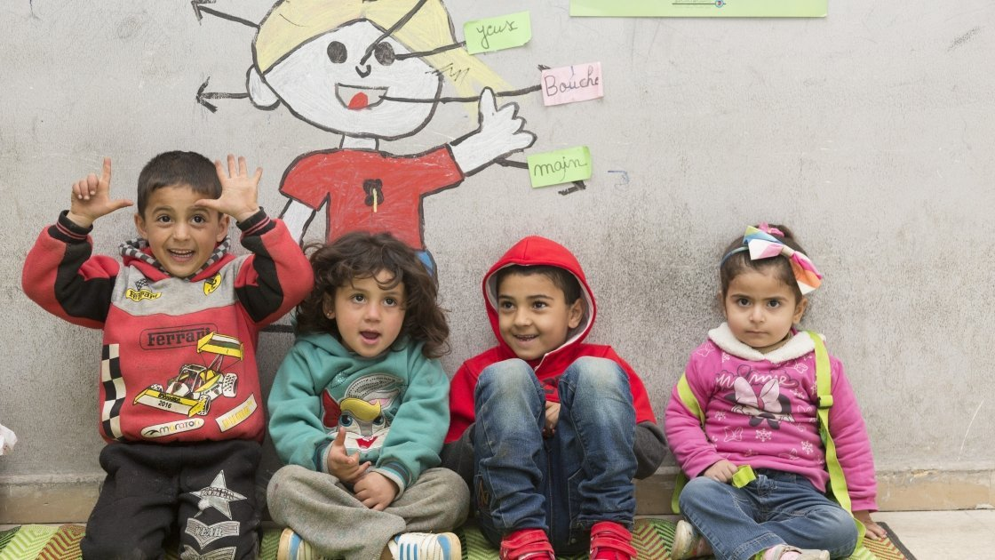 Kareem and his friends taking part in Concern's non-formal education programme at a learning centre in north Lebanon. The children in this class are aged between three and five. Photo: Chantale Fahmi/Concern Worldwide 2017.